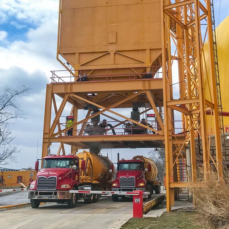 2 trucks loading loading dry bulk goods with Autohatch